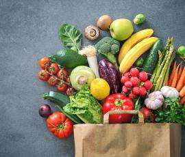 Grocery bag overflowing with healthy vegetables