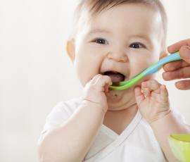 Smiling Baby eating baby food