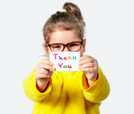 young girl holding a thank you card